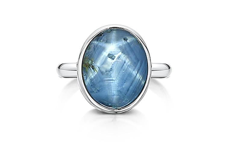 BLUE TOPAZ AND 18 CARAT WHITE GOLD RING