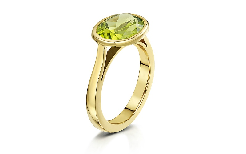 CABOCHON CITRINE AND 18 CARAT YELLOW GOLD RING