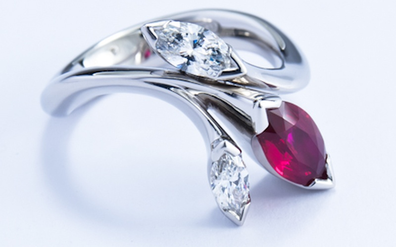 Floral platinum ring with marquise cut ruby and diamonds