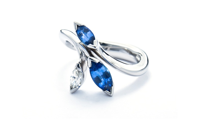 Floral platinum ring with marquise cut diamond and sapphires