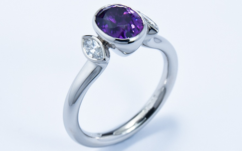 Rub over three stone platinum ring with purple sapphire and diamonds
