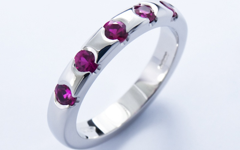 Eternity style platinum ring end set with round brilliant cut rubies
